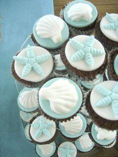 Coastal blue and white cupcakes. Shells and starfish.