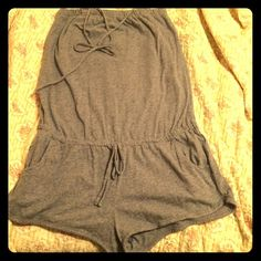 Comfy halter / strapless romper This adorable shorts/halter romper is adorable for summer. It can be worn strapless too by tucking in the halter strings which won't show. It's soft and from H&M LOGG collection. H&M Pants Jumpsuits & Rompers