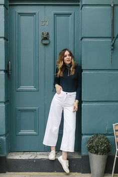 Summer style: high waist white pants and black tight turtle neck