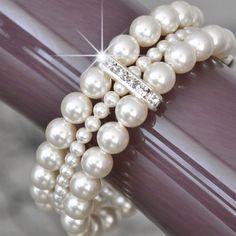 Bridal Cuff Bracelet, Ivory Pearl Bracelet. Bridal Bracelet. Wedding Bracelet. Vintage Style Wedding Jewelry, Chunky Multi-Strand Bracelet. $72.00, via Etsy.