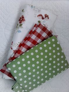 Fabric for Travel Trailer reno: red check, green dot, white/green/red floral. Cheery and Crisp!