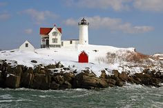 "The famous Cape Neddick ""Nubble"" Lighthouse in York, Maine, after a snowstorm in March 2005."