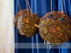 Unique wedding bouquet with green moss. Bridesmaid's carried these non-flowered balls filled with lights and twigs in Raleigh, NC. Rustic, outdoor or barn wedding idea. Navy blue wedding.