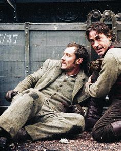 """Watson and Holmes make a daring escape from the Meinhart munitions factory in """"Sherlock Holmes: A Game of Shadows"""" (Jude Law and Robert Downey Jr.)."""