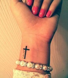 25 Awesome Minimalist Forearm Tattoo Designs For Girls. Design for my first tattoo! Cross Tattoo On Wrist With Bible Verse Cross Tattoo On Wrist, Small Cross Tattoos, Simple Cross Tattoo, Cross Tattoos For Women, Tattoos For Women Small, Side Wrist Tattoos, Cross On Wrist, Faith Tattoo On Wrist, Placement For Small Tattoos