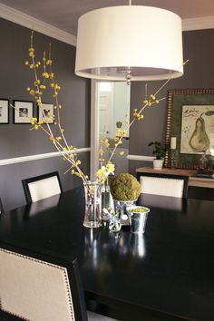 Gorgeous dining area. LOVE the wall color! Not real sold on that lamp shade over the table...but other than that...gorgeous!