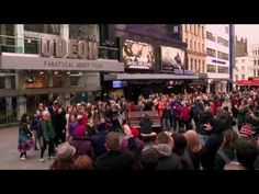 """Here's a little fun for a Sunday afternoon, to celebrate the UK release of the Disney movie Saving Mr. Banks, fans gathered at the spot where Mary Poppins first opened almost 50 years ago in London's Leicester Square, for an rousing rendition of """"Let's Go Fly A Kite."""""""