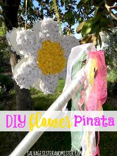 An easy DIY project or craft..flower pinata. Great for kids to do. Wonderful mother's day gift. What mom wouldn't love to get her own pinata. Baby showers, wedding showers, birthdays and more this is a great way to use up boxes, tissue paper and ribbons you have lying around. Great way to reuse or upcycle into something fun!