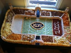 That pool of guac is in desperate need of a chip. | 21 Incredible Football Stadiums Made Of Snacks