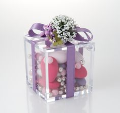 Modern:  High quality Plexiglas small box with three different varieties of confetti candies, silk ribbon, hand-made flower composition.