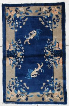 """This Peking weave Art Deco Chinese Oriental rug measures 3' 0"""" x 4' 6"""".  It has a navy blue field with two well drawn phoenix birds circling, encompassed with a gray  ..."""