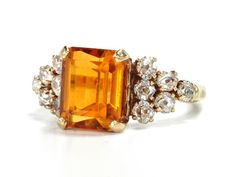 A classic of its period ,1930s original Art Deco Citrine & Diamond Ring. As bespoke jewellers we often make a ring similar to this with Aquamarine as central stone - To see an original with citrine is a refreshing variation. Why not use this design to inspire you for your own original vintage inspired engagement ring ?. If you'd like a vintage inspired ring made to your very own specification,then visit us at www.designer-engagement-rings.co.uk.