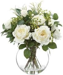 white roses in a short arrangement