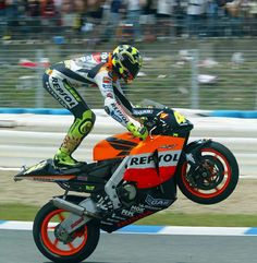 Valentino Rossi- at the start of the four stroke era Vale was so far beyond his 'competitors' in terms of skill he had to find ways of making it more difficult just to finish in the time zone. He may have completed the whole race riding like this.  Or not.