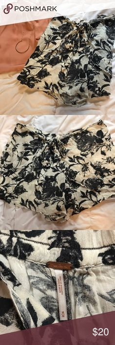 Free People wide leg shorts Free People wide leg shorts with wrap overlay. Super flattering black and cream print. 13 inches from waist to bottom, approximately 30 inch leg opening. 100% rayon, loose summer feel Free People Shorts Skorts