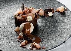 """Inspiring """"Poire Belle Helene"""" from Valrhona Cercle V Cafe Boulud's Pastry Chef Ashley Brauze! (The Poire Belle Helene is a classic French dessert created by Auguste Escoffier in 1864 after the opera """"La Belle Helene""""!). Valrhona MANJARI 64% (Single Origin Madagascar) sauce, GUANAJA 70% Chocolate Financier, red Anjous pears poached with their skins in rosemary syrup, Maple Diplomat, Candied black walnuts and black walnut ice cream"""