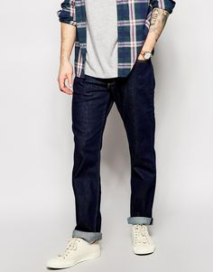 """Straight jeans by Lee Stretch cotton denim One wash rinse Classic five pocket styling Zip fly Straight fit - cut with a straight leg Our model wears a size Medium and is 178cm/5'10"""" tall Machine wash"""