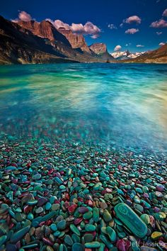 Massive glacial forces have shaped and polished the stones in and around Upper St. Mary Lake.  The color and texture of these stones provides the perfect foreground in this beautiful scene.