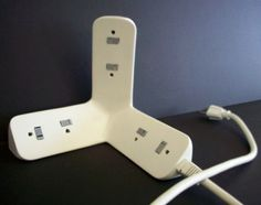 3D power strip that fits into a corner. Genius.