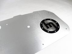 These lightweight aluminum door panels replace the existing ones on your MX-5 NA. They give a vintage look to your interior while being extremely strong and light. Door handles are not included. This listing is for a pair. Specifications: Brushed Aluminum Bare aluminum or glossy anodized black available Perfect fit fittings supplied Speaker covers + speaker grilles included This is part of a long list of aluminum products CarbonMiata started to work on. Door cups/door pulls/door latches w...