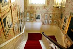 11 Downing Street staircase, covered with political cartoons, caricatures and engravings of past Chancellors of the Exchequer.