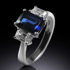 Step cut octagon cut sapphire and diamond ring by Simon Wright