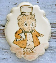 Hand painted sugar cookies for a first birthday.  Beatrix Potter characters