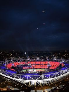 Sky divers dressed as the Queen and James Bond parachute from a helicopter over the Olympic Stadium during the Opening Ceremony on 27 July.
