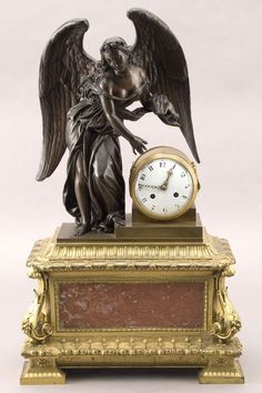 French bronze, ormolu and marble mantle clock