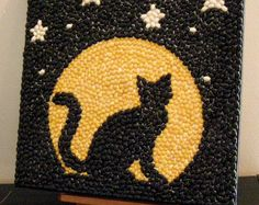 Halloween Black Cat and Moon Mosaic Bean Art This black cat is showing off i. Projects For Kids, Art Projects, Coffee Bean Art, Seed Craft, Seed Bead Art, Arts And Crafts, Paper Crafts, Mosaic Projects, Button Art