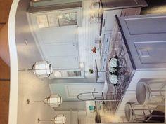 White kitchen, grey granite, glass cabinets