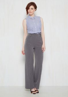 Poise and professionalism? Check and check. Bold grey pants to complete your self-assured attitude? With these high-waisted slacks, you got 'em! Boasting vertical accent seams down their wide legs, these four-pocketed trousers command attention with each strut you take in their retro silhouette.