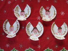 Leuke kerstengeltjes van kartonnen bordjes.
