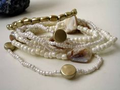 8 white and champaigne bracelets