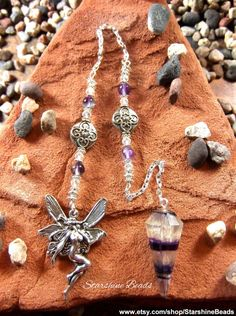 Rainbow Fluorite Fairy Pendulum by StarshineBeads  #handmade #pendulums #pendulum #divination #fairy #faeries #faries #fae #fantasy #wicca #wiccan #pagan #fluorite #rainbowfluorite #beadedpendulums #silverpendulum #hypnosis #uniquegifts #giftideas #gifts #crystals