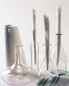 The insides of glass decanters can be a challenge to dry. You can't air-dry them; the water only condenses and becomes trapped, eventually discoloring the glass. And only a genie could fit through their narrow openings to dry them with a towel. Try this: Tightly roll a paper towel, and insert it three-fourths of the way into the bottle; it will absorb the moisture