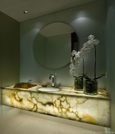 Onyx Vanity Counter with under-lighting... No need for extra accessories, or a frou-frou mirror in this Powder Room--- just the white orchids. Design & Photography by Patricia Gray-- Vancouver, Canada Design & Photography by Patricia Gray-- Vancouver, Canada