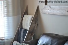 Creating a blanket ladder with wood from the local hardware store. This would be a cute ladder for small quilts too.