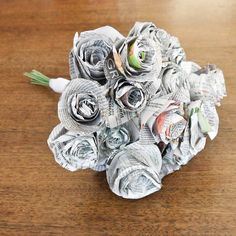 Newspaper bouquet. Such a simple, sweet craft! Glue to a package to add some flare or substitute for a bow.