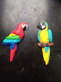 Polymer clay/ Fimo parrots, to be made into broaches
