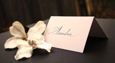 Timeless elegance – simple tent fold wedding place names with calligraphy