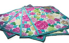 Reversible Quilted Placemats - Retro Flowers. $40.00, via Etsy.