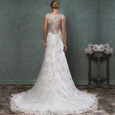 Romantische bruidsjurk van kant met lage open kanten rug