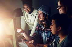 Shot of a business team looking at a computer screen together on a night shift at work - stock photo #1419204