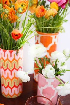 Jill Rosenwald vases. Recreate using glass vases and scrapbooking papers