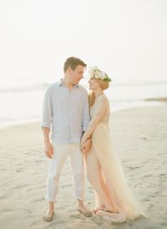 Love her dreamy, romantic, lace topped dress with wispy fabrics and his light wardrobe.