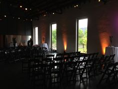 Ceremony in front of tall windows layout.