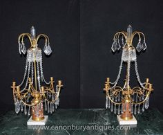 - Stunning and unique pair of French Empire style candelabras in the form of chandeliers<BR> - Opulent look to this important pair<BR> - Six branches to the candelabras in ormolu, offset by glass and marble base<BR> - Purchased from a dealer off the Champs Elysee in Paris<BR> - Please come and view in our North London / Hertfordshire antiques showroom, open to the public<BR> - We ship to every corner of the planet - please get in touch for a shipping quote<BR> - Offered in great shape with n... French Empire Chandelier, Antique Table Lamps, Antique Bookcase, Empire Style, North London, Bookcases, Candelabra, Champs, Chandeliers