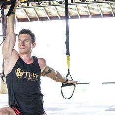 Trainer Mark Mariani using the TRX Suspension Trainer