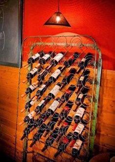 old mattress boxsprings repurposed as a wine rack Old Bed Springs, Mattress Springs, Old Mattress, Industrial Light Fixtures, Industrial Lighting, Vasos Vintage, Bed Spring Crafts, Unique Wine Racks, Outdoor Wall Art